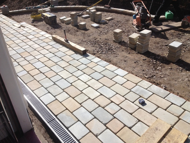 Natural stone setts laid by Dempsey