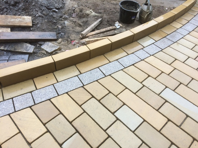 Natural stone patios laid by approved landscaping professionals in  the North West